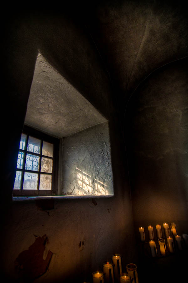 Presidio La Bahia chapel window with candles