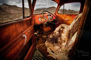 HDR photograph of the inside of a truck in the Rhyolite Ghost town near death valley